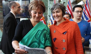 The deal to protect the Great Bear Rainforest took 16 years to complete. It bans commercial logging on most of the land, gives First Nations peoples a greater say in managing the forest and ensures timber production for forestry companies for years to come. Here, Premier of British Columbia, Christy Clark, left, stands with Nicole Rycroft, executive director of nonprofit Canopy, on the day of the deal's announcement.