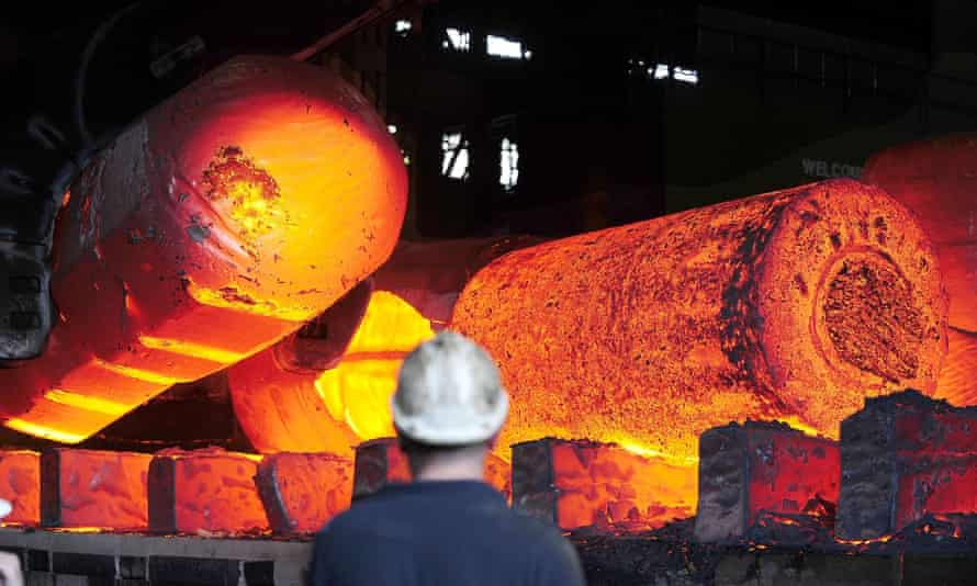 Red hot metal being moved across the heavy forge at Sheffield Forgemasters.