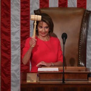 Nancy Pelosi holds the gavel.