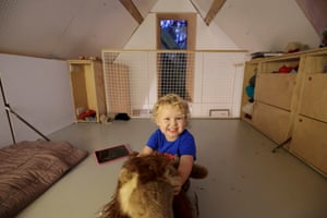 Three-year-old Tom in the roof space of the family's tiny house.