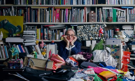 'It's my job to throw out ideas to my designers, to think laterally': Paul Smith in his office, surrounded by books, magazines and samples. It's been called 'the paracetamol room' by staff because it is such a sensory overload.