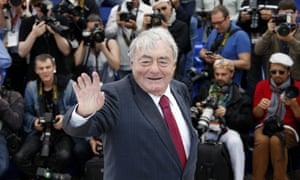 """FILES-FRANCE-CINEMA-LANZMANN(FILES) In this file photo taken on May 19, 2013 French director Claude Lanzmann waves while posing during a photocall for his film """"The Last of the Unjust"""" presented Out of Competition at the 66th edition of the Cannes Film Festival in Cannes. Lanzmann, 92-years-old, died on July 5, 2018, according to his publishers. / AFP PHOTO / Valery HACHEVALERY HACHE/AFP/Getty Images"""