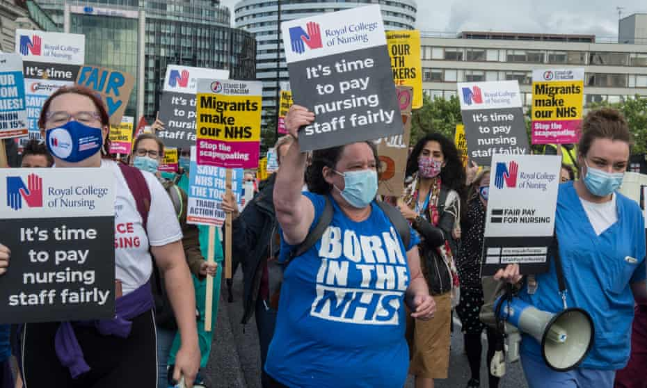 NHS workers march to Downing Street in July to demand a larger pay rise