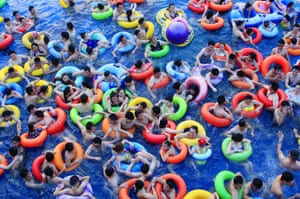 Holidaymakers crowd a swimming pool at a water park in Nanchang