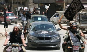 Fighters from al-Qaida's Syrian affiliate the al-Nusra Front drive in the northern Syrian city of Aleppo flying Islamist flags as they head to a frontline on 26 May 2015.