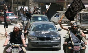 Al-Nusra Front fighters fly Islamist flags in Aleppo.