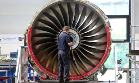 An employee works on an aircraft engine at the Rolls-Royce factory in Derby.