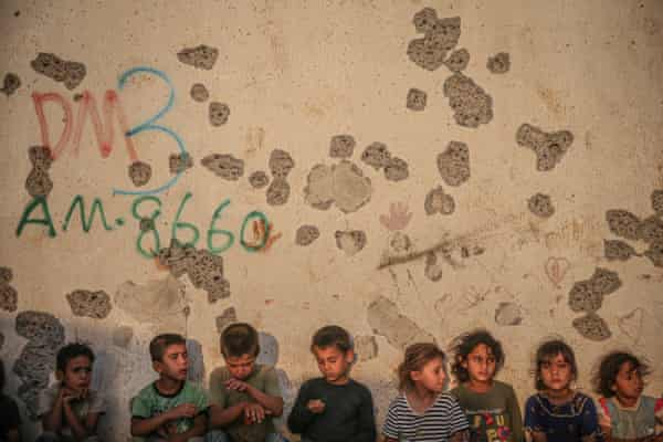 Children in camps along the frontier between Turkey and north-west Syria