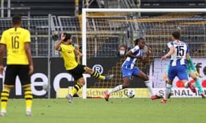Emre Can of Borussia Dortmund scores the opening goal past Hertha keeper Rune Jarstein.