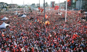 Demonstrators wave Turkish flags and pictures of Ataturk, founder of modern Turkey, in Istanbul's Taksim Square on Sunday.