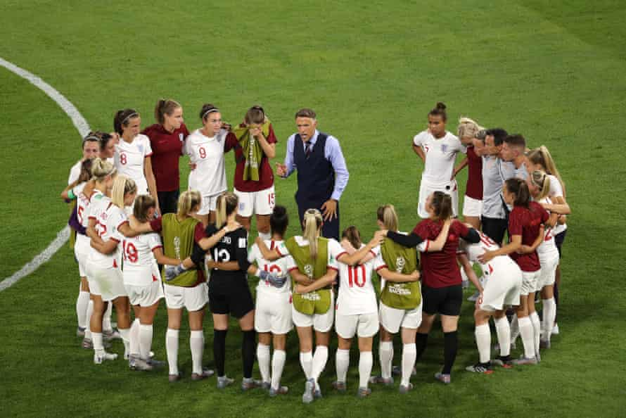 Phil Neville, head coach of England, talks to his players following their semi final defeat to the USA at Stade de Lyon.