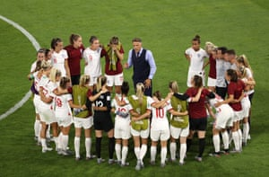 Philip Neville talks to his players after England's defeat in the Women's World Cup semi-final, 2 July