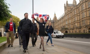Leave supporters celebrate opposite the houses of parliament in London
