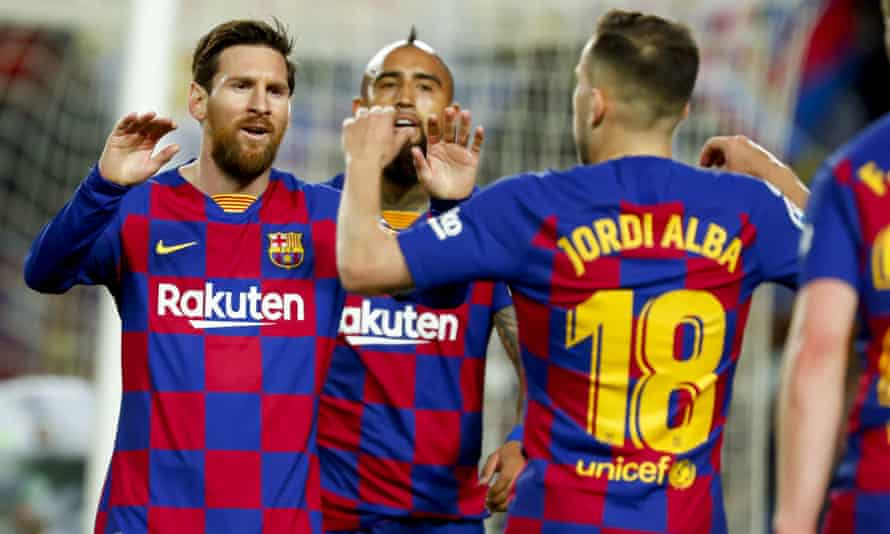 Lionel Messi (left) and his Barcelona teammates are in discussions with the club over a pay cut.