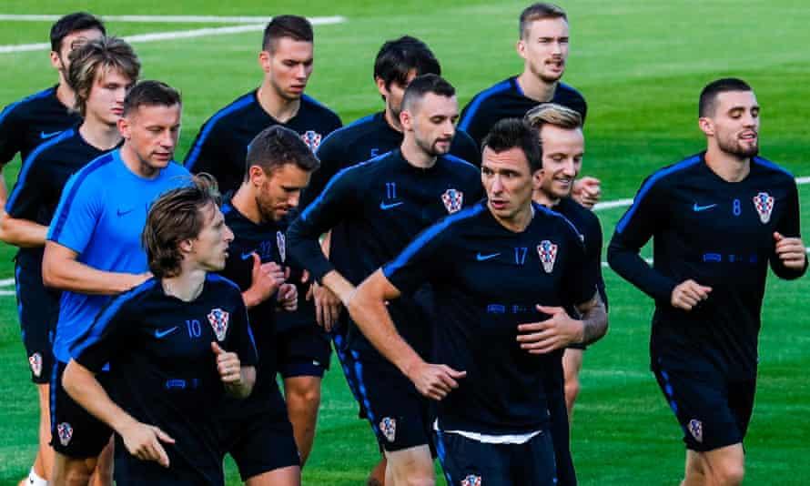 Croatia in training ahead of 2018 FIFA World Cup final match against France MOSCOW, RUSSIA - JULY 13, 2018: Luka Modric, Mario Mandzukic, Ivan Rakitic, Mateo Kovacic (L-R front), coach Ivica Olic, Josip Pivaric and Marcelo Brozovic (L-R background)