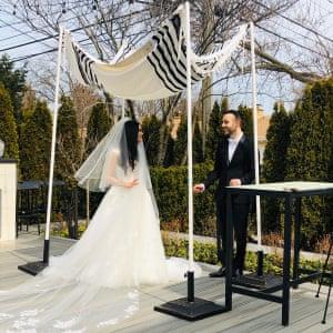 Eliana Amrani and Elliot Birn get married in her parents' back garden in Chicago.