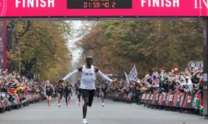 Kenya's Eliud Kipchoge celebrates as he crosses the finish line at the end of his sub-two-hour marathon in Vienna.