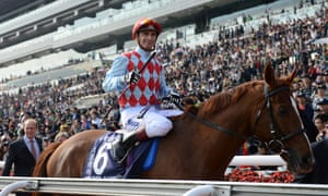 Red Cadeaux, with jocket Gerald Mosse, after winning the Hong Kong Vase in 2012.
