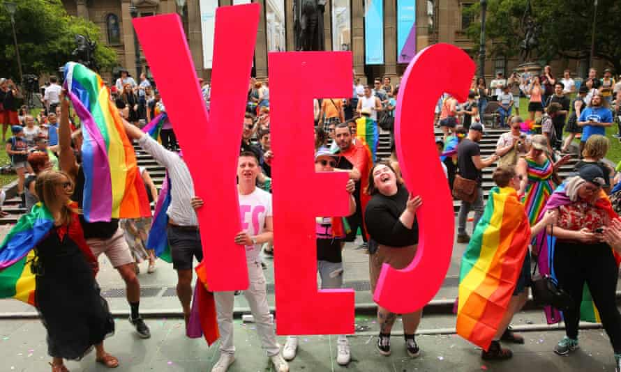 People celebrate as the result of same-sex marriage postal survey is announced on 15 November 2017 in Melbourne, Australia.