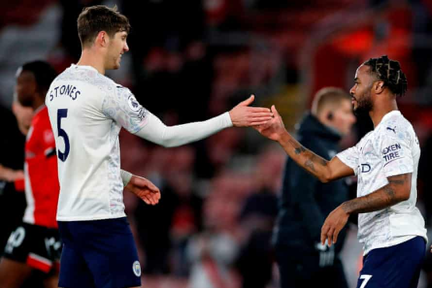 John Stones celebrates with Raheem Sterling after Manchester City's 1-0 win at Southampton