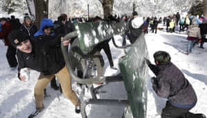 Tacoma, Washington: People taking part in a public snowball fight use a table as shield at Wright Park