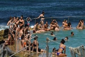 People cool off in the pool at Bronte Beach in Sydney on Saturday. People are being urged to stay 1.5 metres away from others.