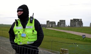 A security guard at the fenced-off Stonehenge site