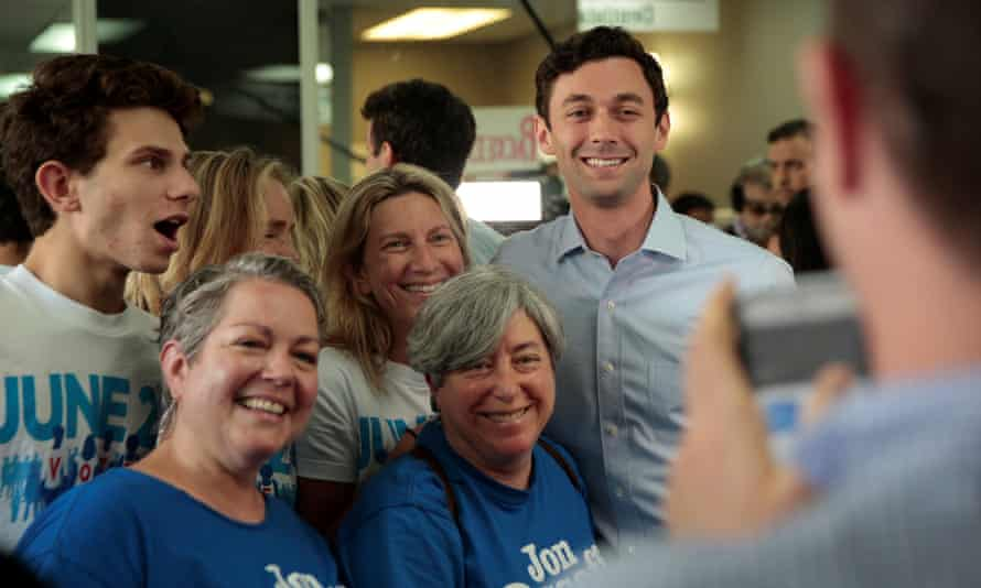 Democratic candidate Jon Ossoff has his picture taken with supporters in Chamblee, Georgia Monday.