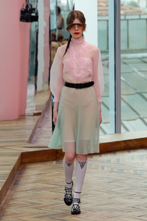Transparent layers in pastel pink and green, finished with ultra-modern sunglasses.