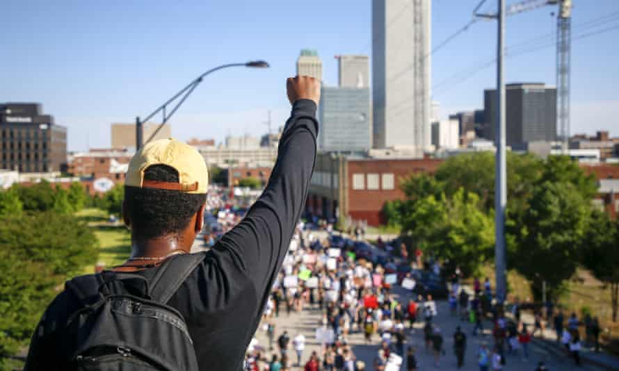 People protest in Tulsa on 31 May to honour the 99th anniversary of the race massacre and George Floyd, who was killed in police custody.