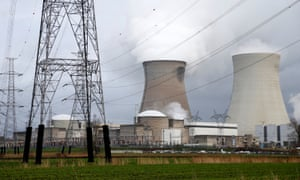 High-voltage power lines are seen next to cooling towers of the Doel nuclear plant in Belgium.