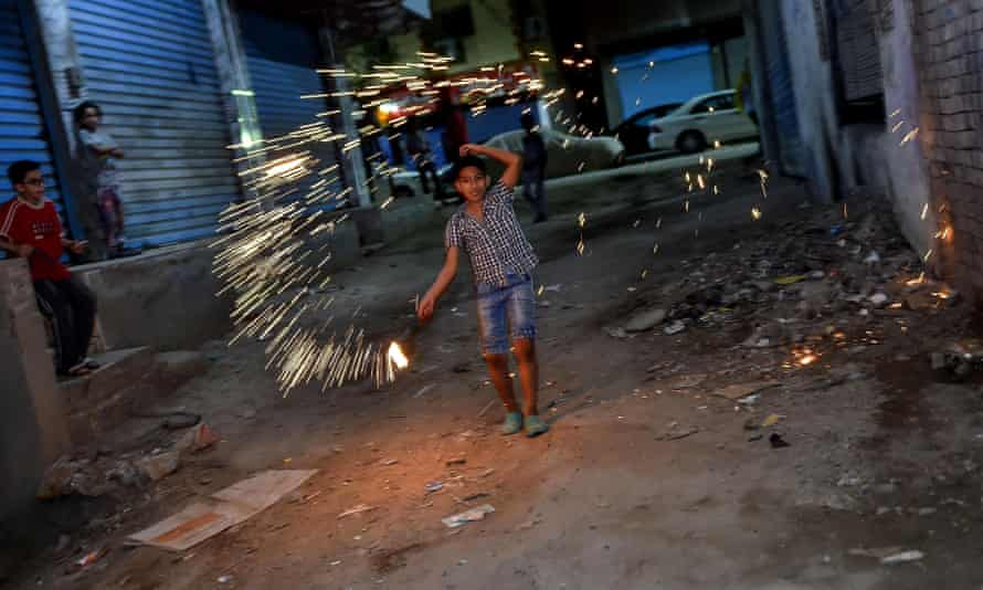 Egyptian children play with fireworks at the start of Ramadan.