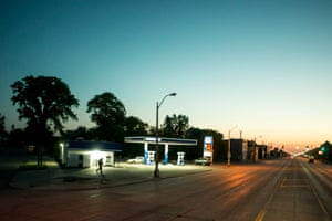 View East towards the rising sun. Residents are afraid to pump gas in city limits, lest they be carjacked. Gratiot at Concord Avenue, Detroit, 2014