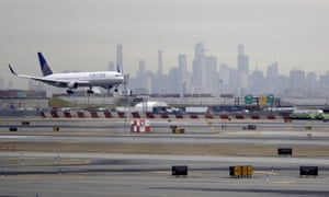 A United Airlines jet prepares to land at Newark Liberty international airport in New Jersey on 23 January.