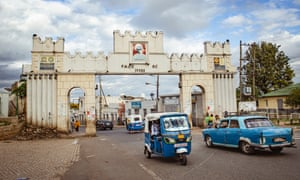 A Peugeot taxi entering the main city gate, which leads into the center of the 1000-year-old walled city of Harar, Ethiopia.