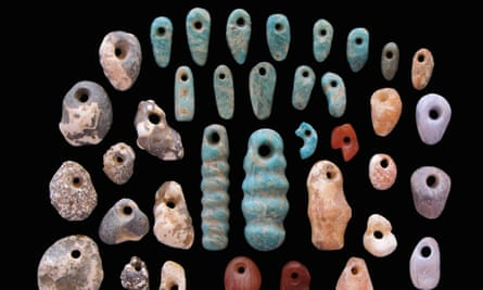 Stone pendants and earrings from the communal cemetery of Lothagam North, Kenya, built by eastern Africa's earliest herders up to 5,000 years ago.