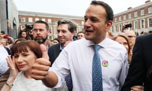 Taoiseach Leo Varadkar, centre, the health minister Simon Harris, second left, and the culture minister Josepha Madigan arrive at Dublin Castle for the results of the referendum on the eighth amendment of the Irish constitution