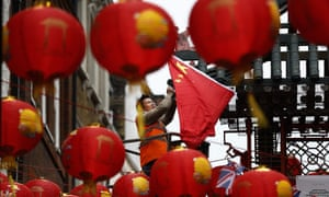 The Chinese flag is hung in London's Chinatown ahead of the visit of Xi Jinping. The president will also be greeted by protests over human rights violations in China.