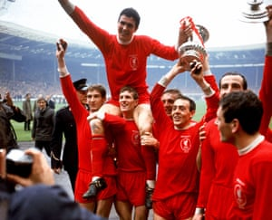 Ian St John holds the FA Cup trophy aloft with Captain Ron Yeats (top) and jubilant teammates Geoff Strong, Wilf Stevenson, Peter Thompson, Gerry Byrne, and Ian Callaghan
