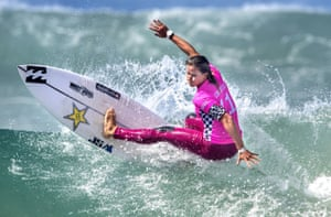 Courtney Conlogue surfs in a quarter-final heat at the US Open of surfing in Huntington Beach, California
