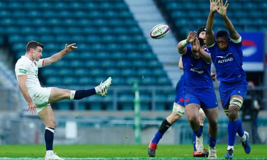 George Ford of England kicks despite French pressure in Autumn Nations Cup final.