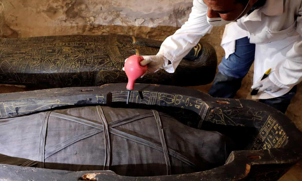 An archaeologist works on another sarcophagus discovered inside the tomb.