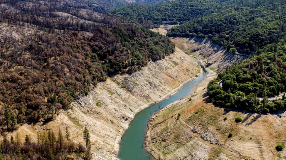 Dry banks rise above water in Lake Oroville on Sunday 23 May in Oroville, California.