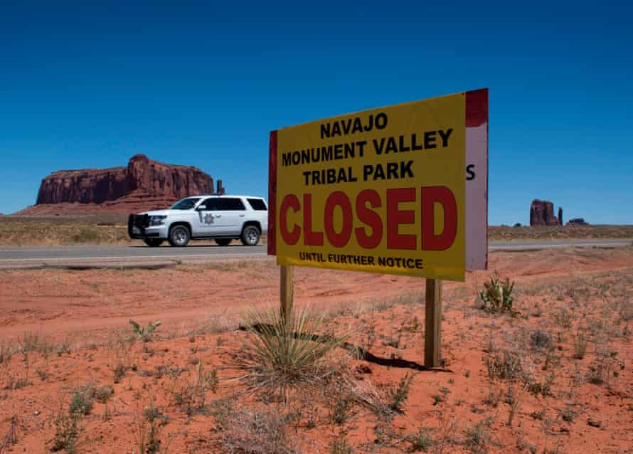 A Navajo park ranger drives outside the Monument Valley Tribal Park in Arizona.