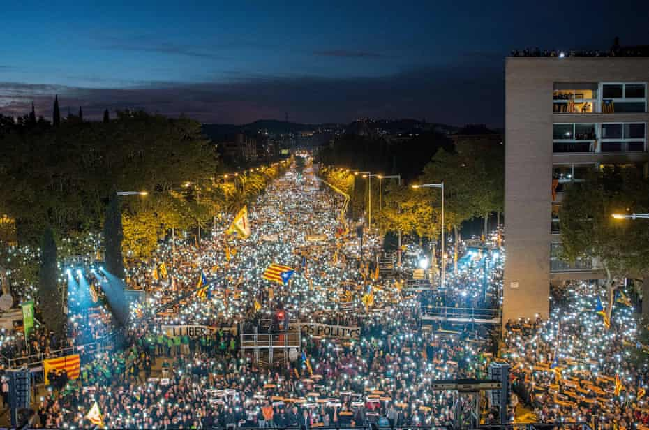 Catalonia independence supporters march at a rally in Barcelona, Spain