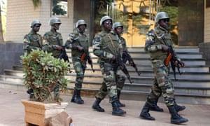 Malian soldiers on patrol in the capital Bamoko