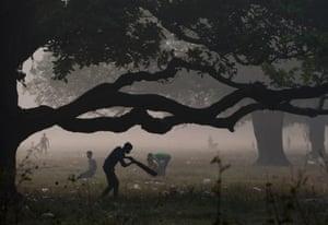 A youth plays cricket in the Maidan area of Kolkata, India