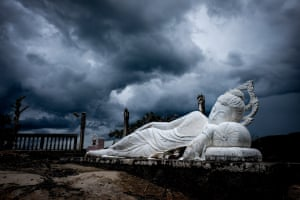 Stormy skies over Wat KrailatA heavy brewing storm made for a contrasting background to the peaceful, white-stone reclining Buddha at Wat Krailat. Situated just off the coast of Hua Hin, Thailand, this huge thunderstorm rolled in from the sea not long after this photo was taken Photograph: ToriaFin/GuardianWitness