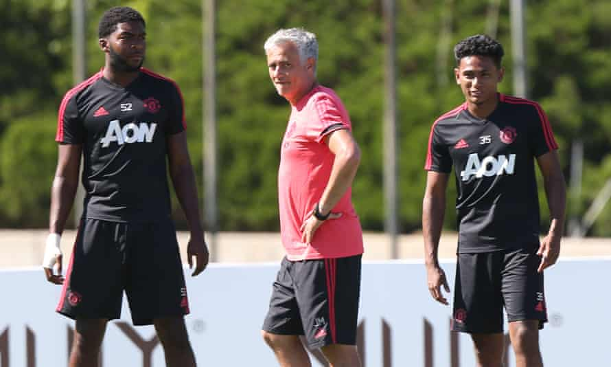 José Mourinho alongside Ro-Shaun Williams, left, and  Demetri Mitchell during a Manchester United training session in Los Angeles