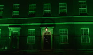 Downing Street is illuminated in green to mark the anniversary of the blaze